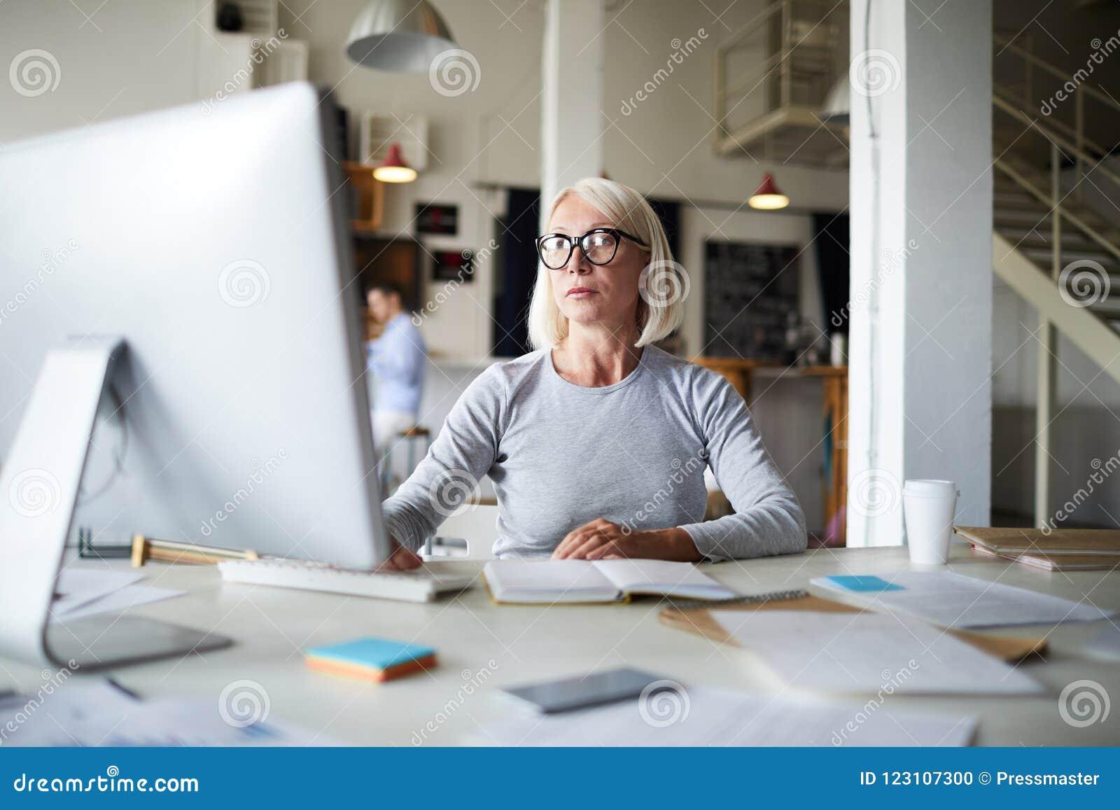 Mature office blonde