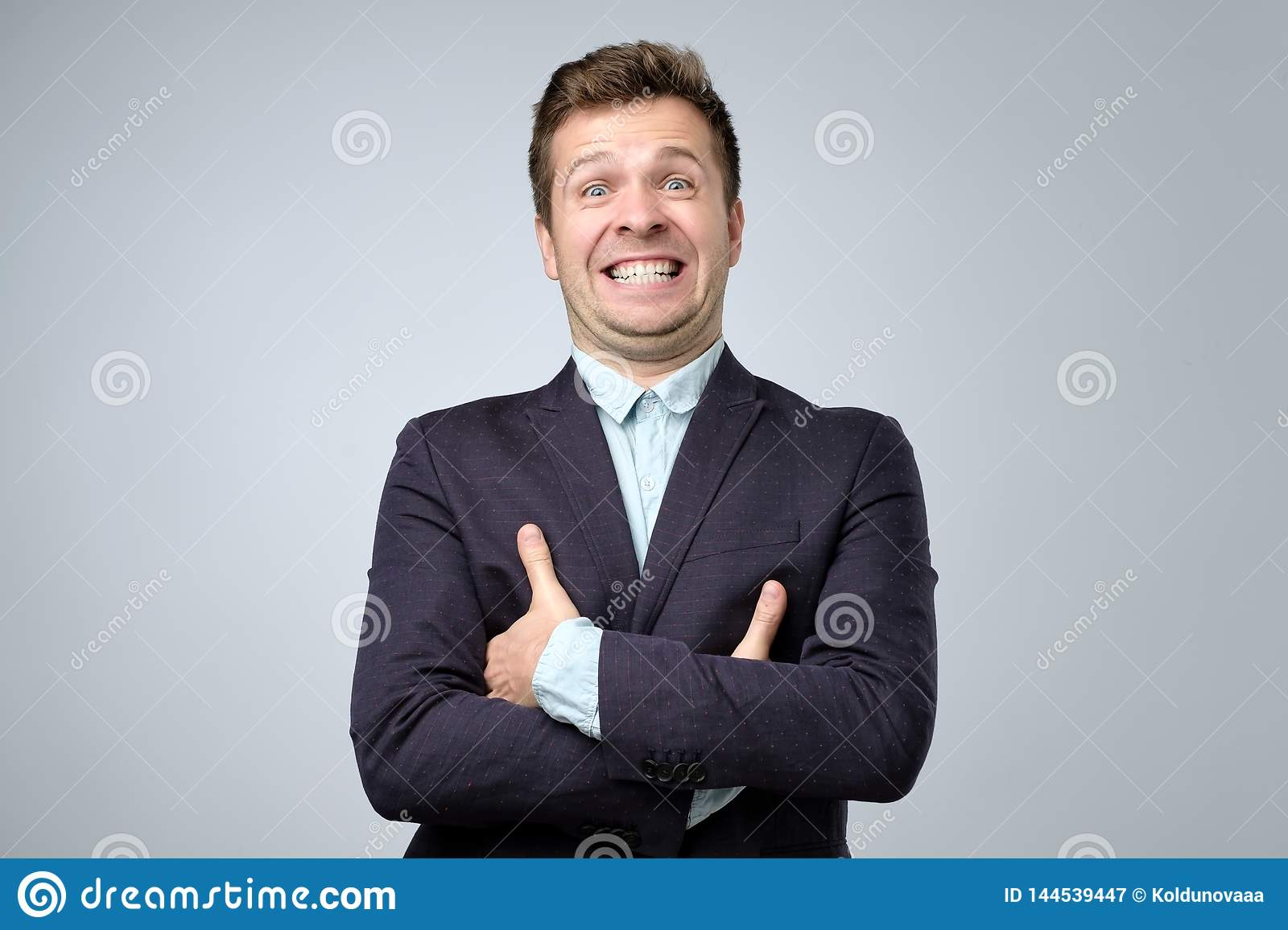 Mature business man laughs from ear to ear, giggles on the funny stories.