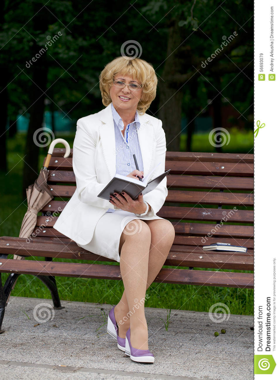 Mature Business Woman In A Jacket With Diary Sitting On A