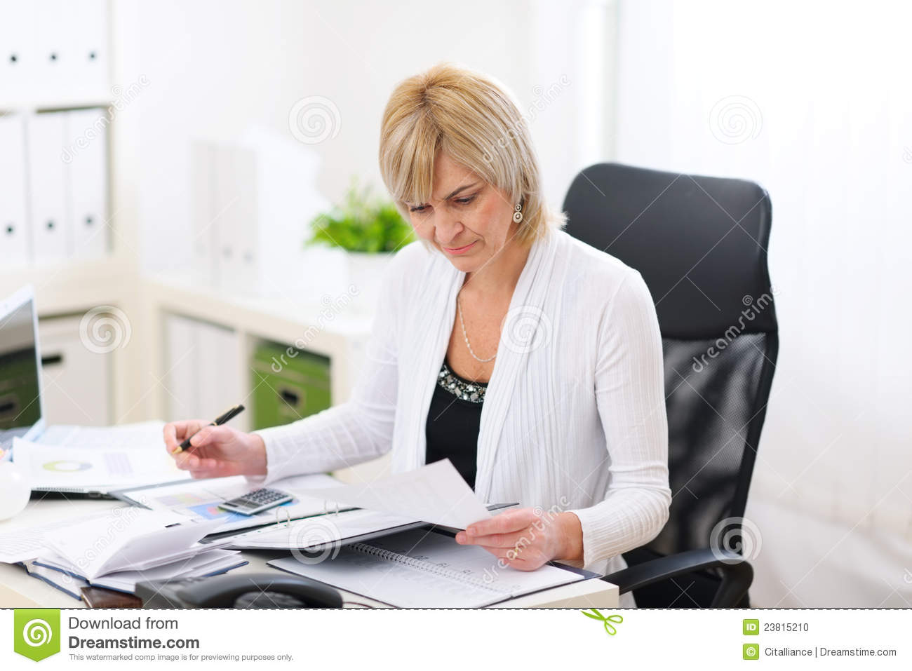 mature business woman working at office stock photo - image of