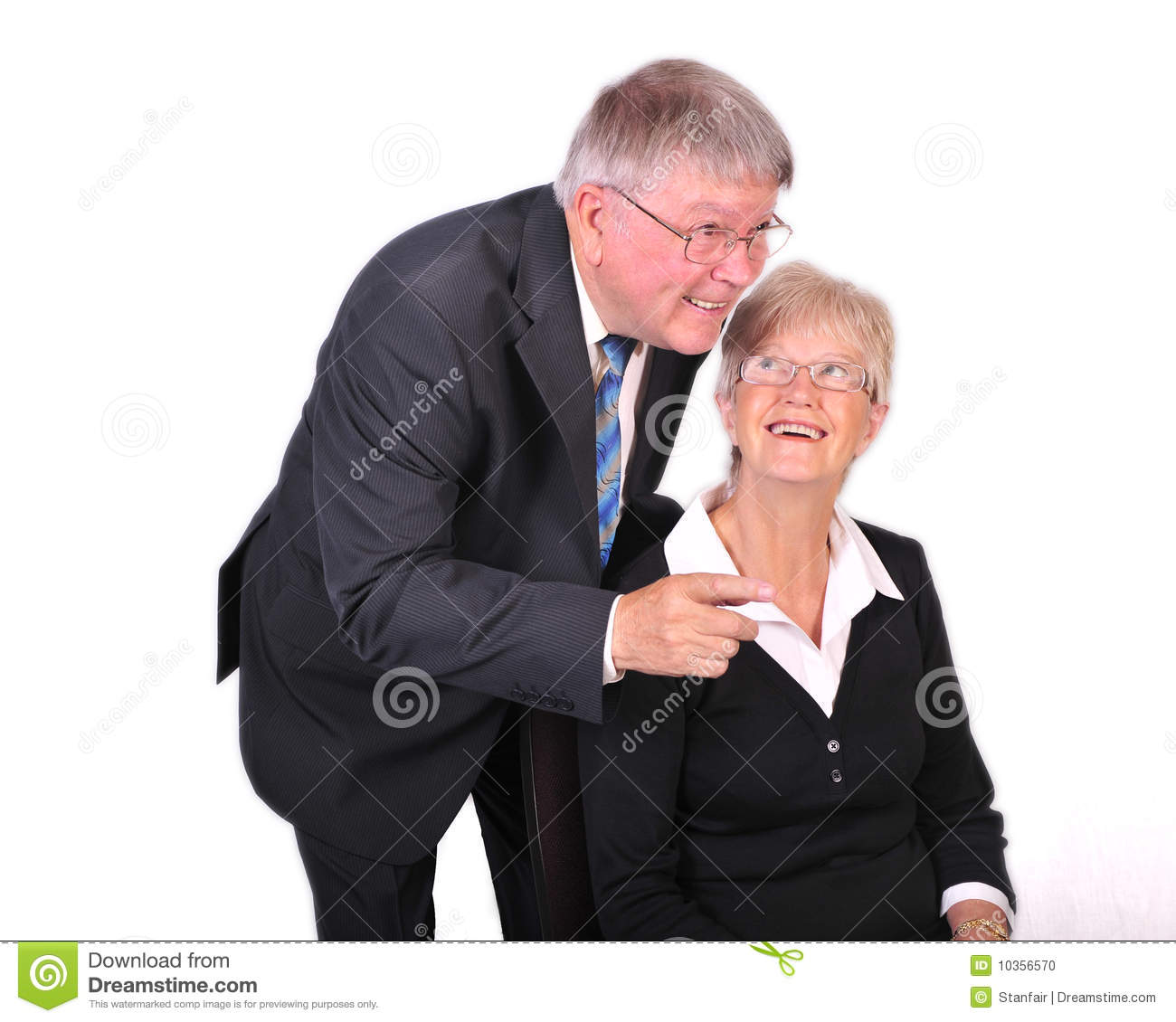 mature businessman with secretary looking up at hi stock photo