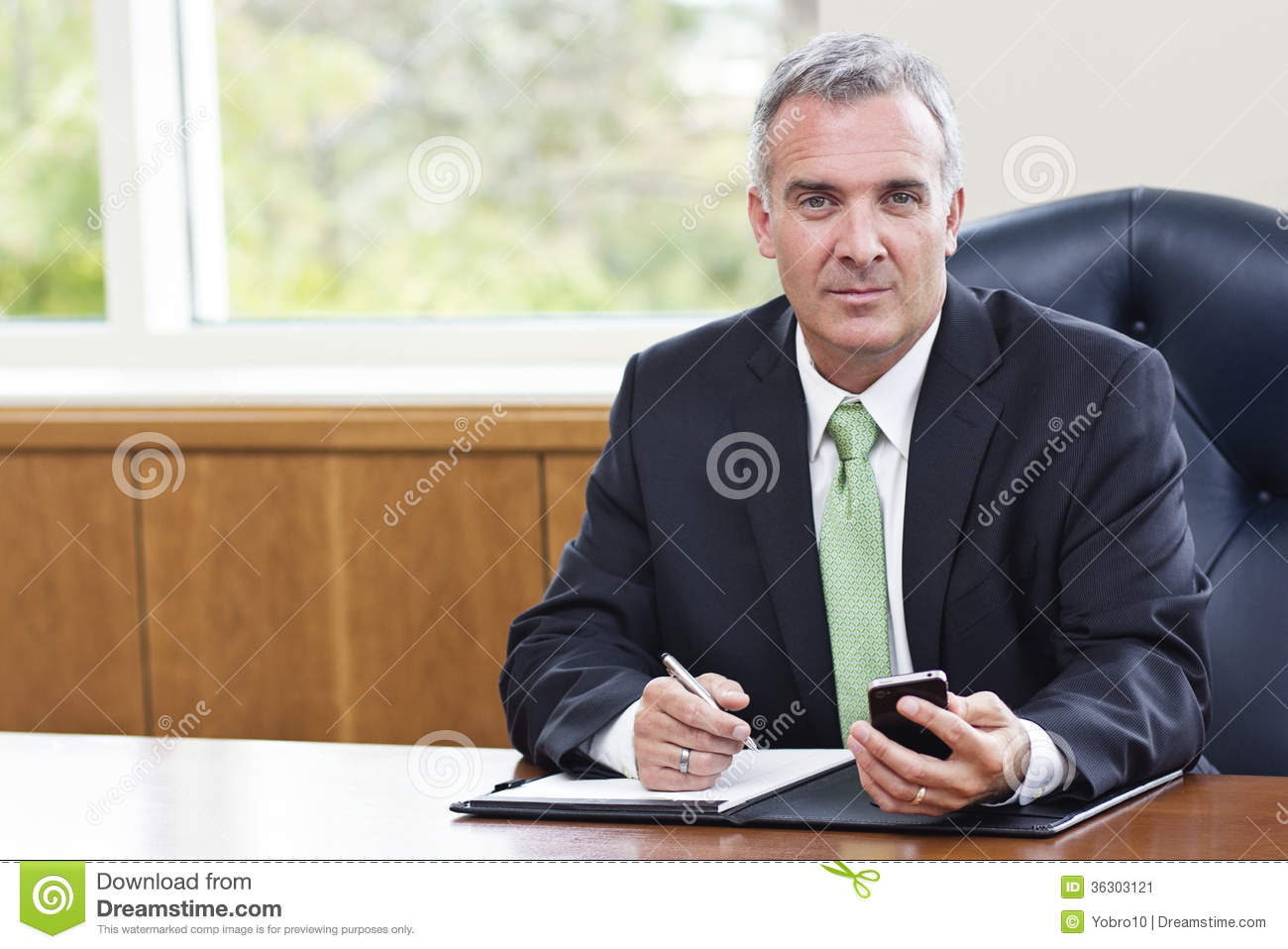Mature Businessman Working In His fice Stock Image