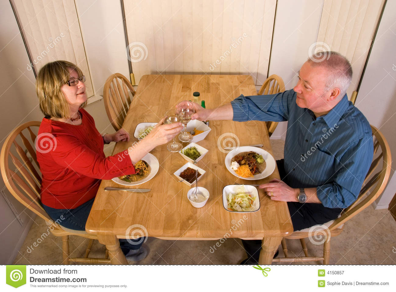 nude couple eating dinner