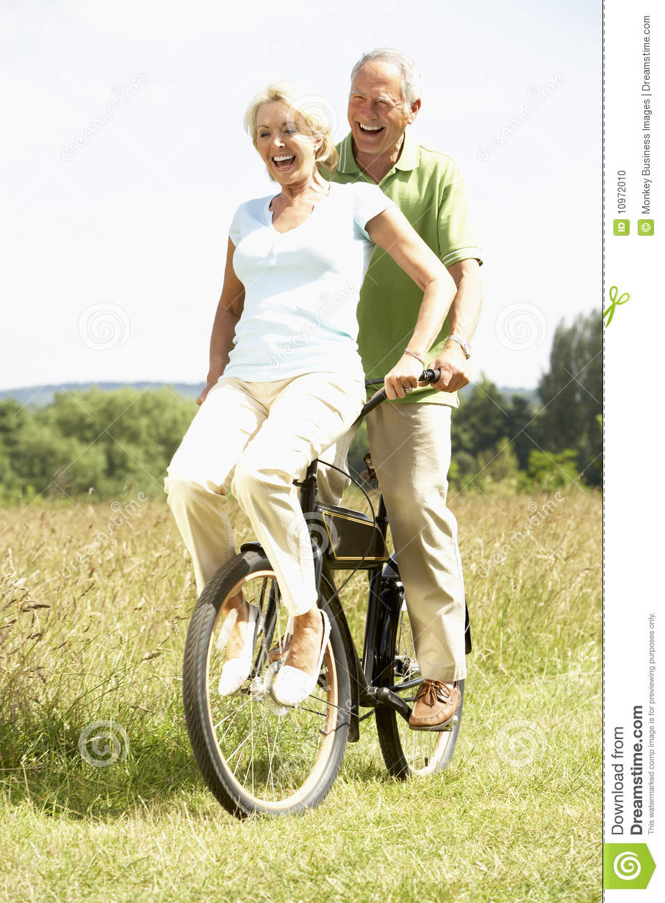 mature couple riding bike in countryside stock photo - image of