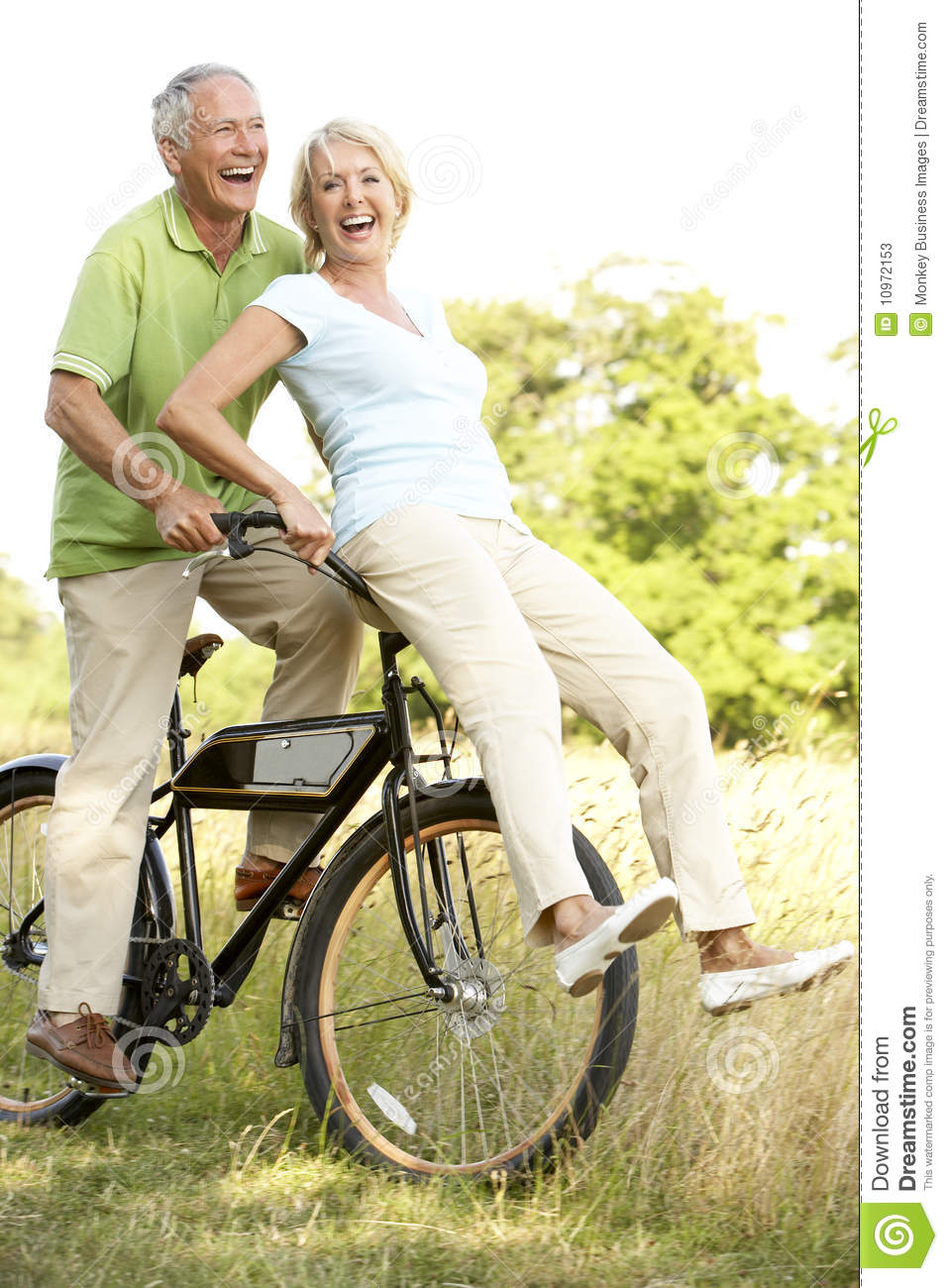 mature couple riding bike in countryside stock image - image of