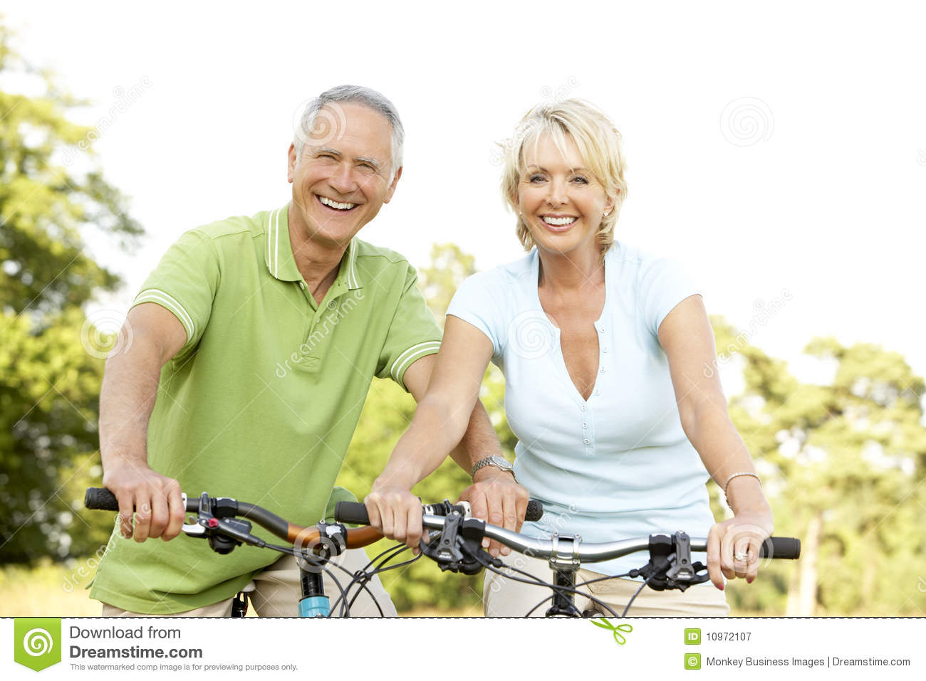 mature couple riding bikes stock image. image of male - 10972107