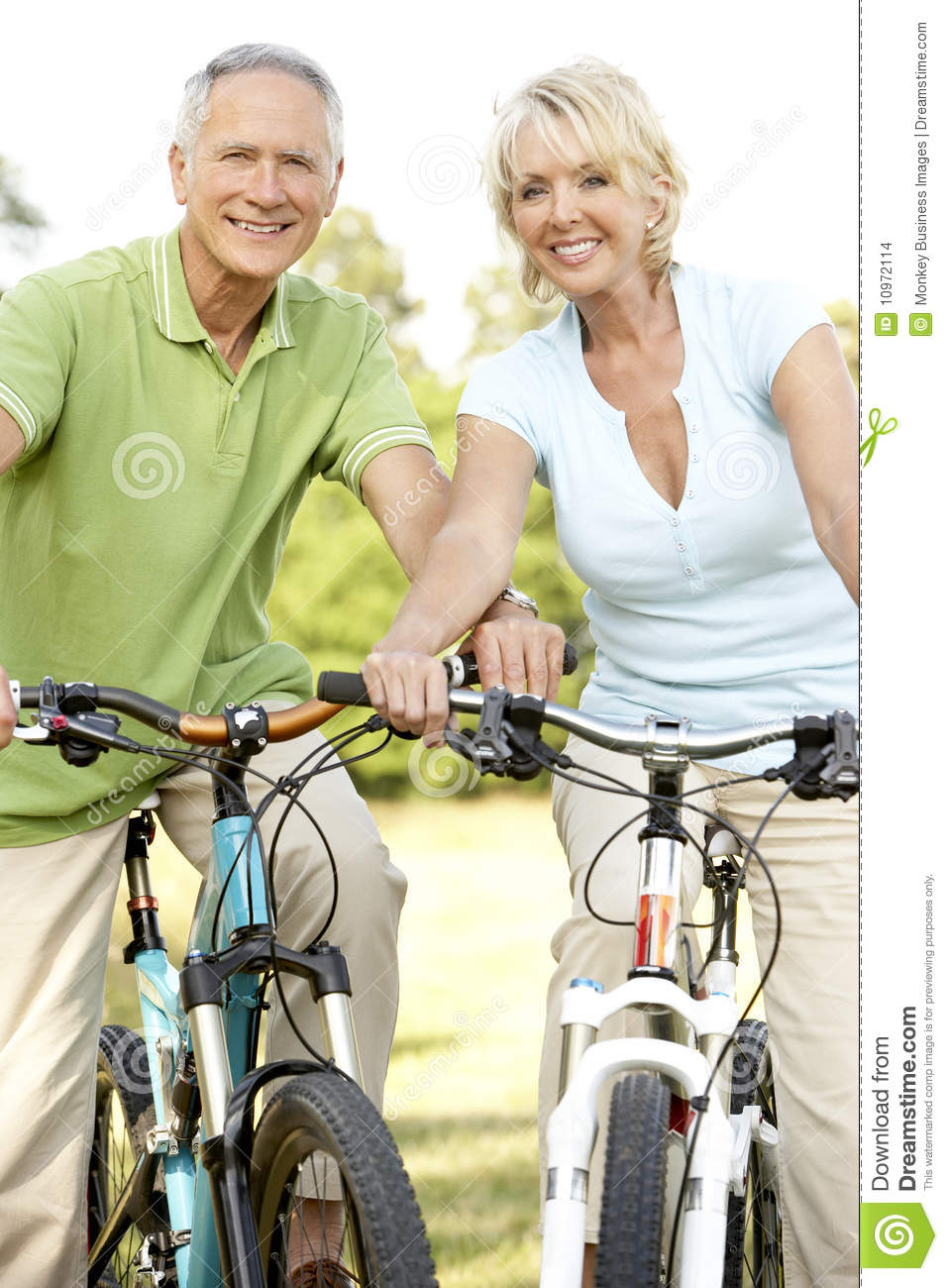 mature couple riding bikes stock photo. image of active - 10972114