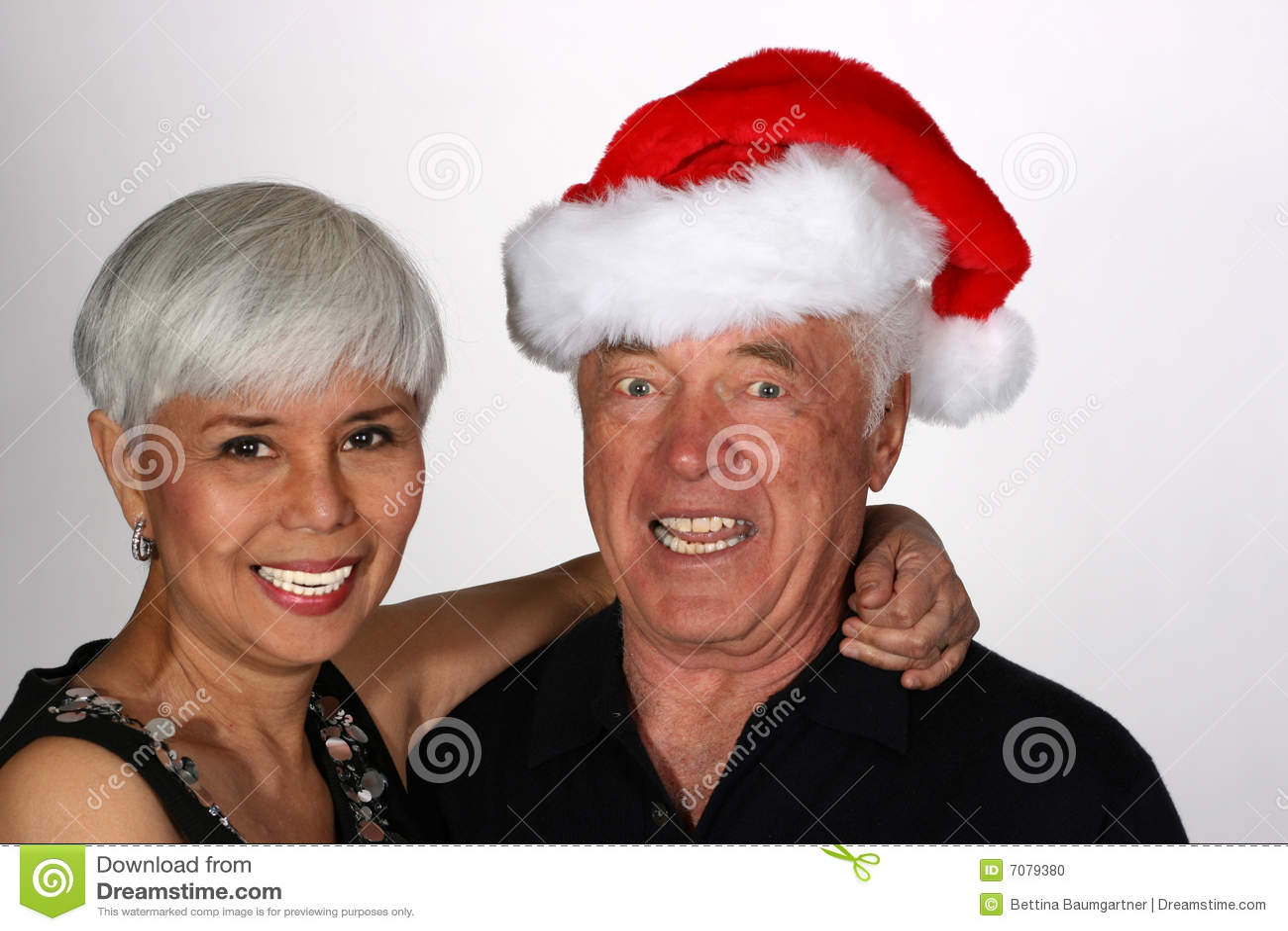 Mature couple with santa hat stock photo image 7079380
