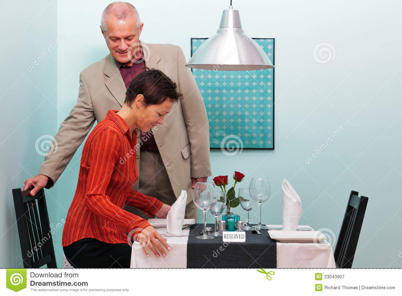 Mature Couple Sitting Down In A Restaurant Stock Image