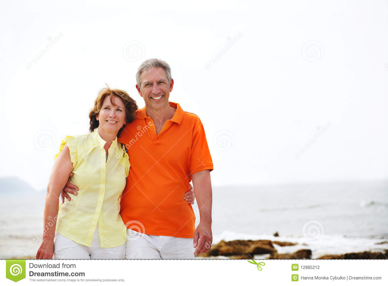 Couple Mature mature couple walking along the beach. stock photo 12885212 - megapixl
