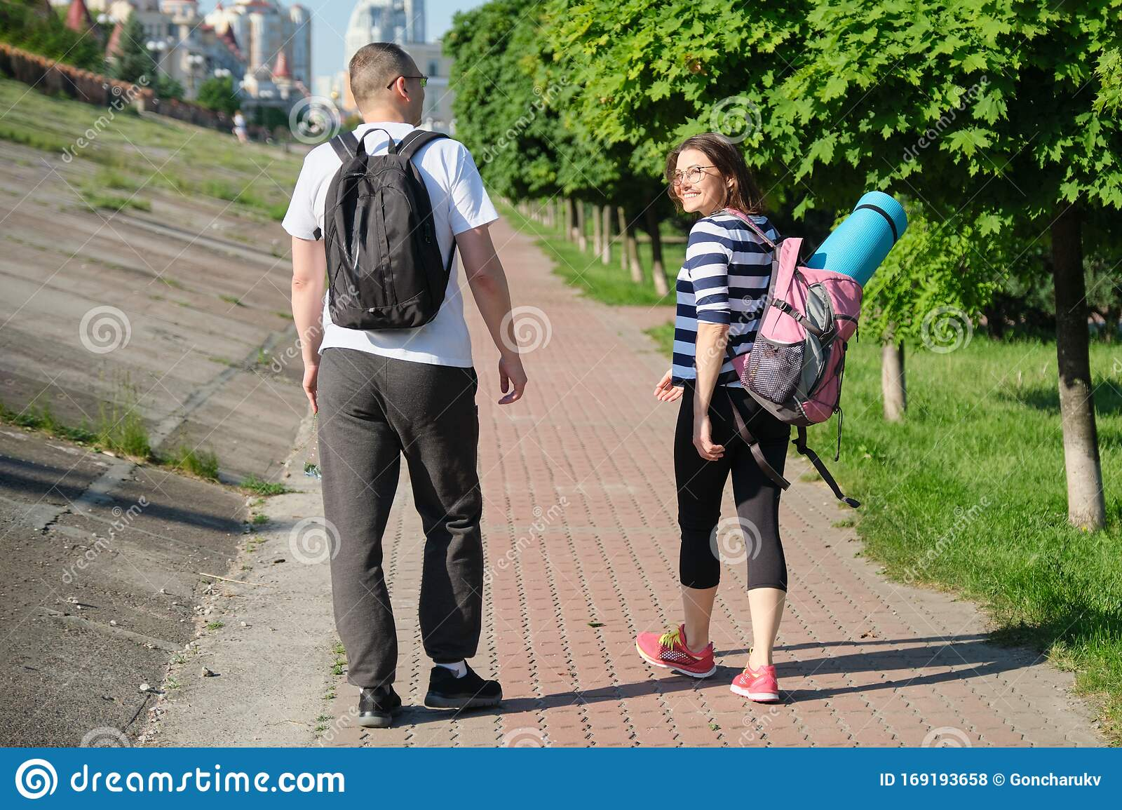 Mature Couple Walking And Talking Man And Woman Stock Photo