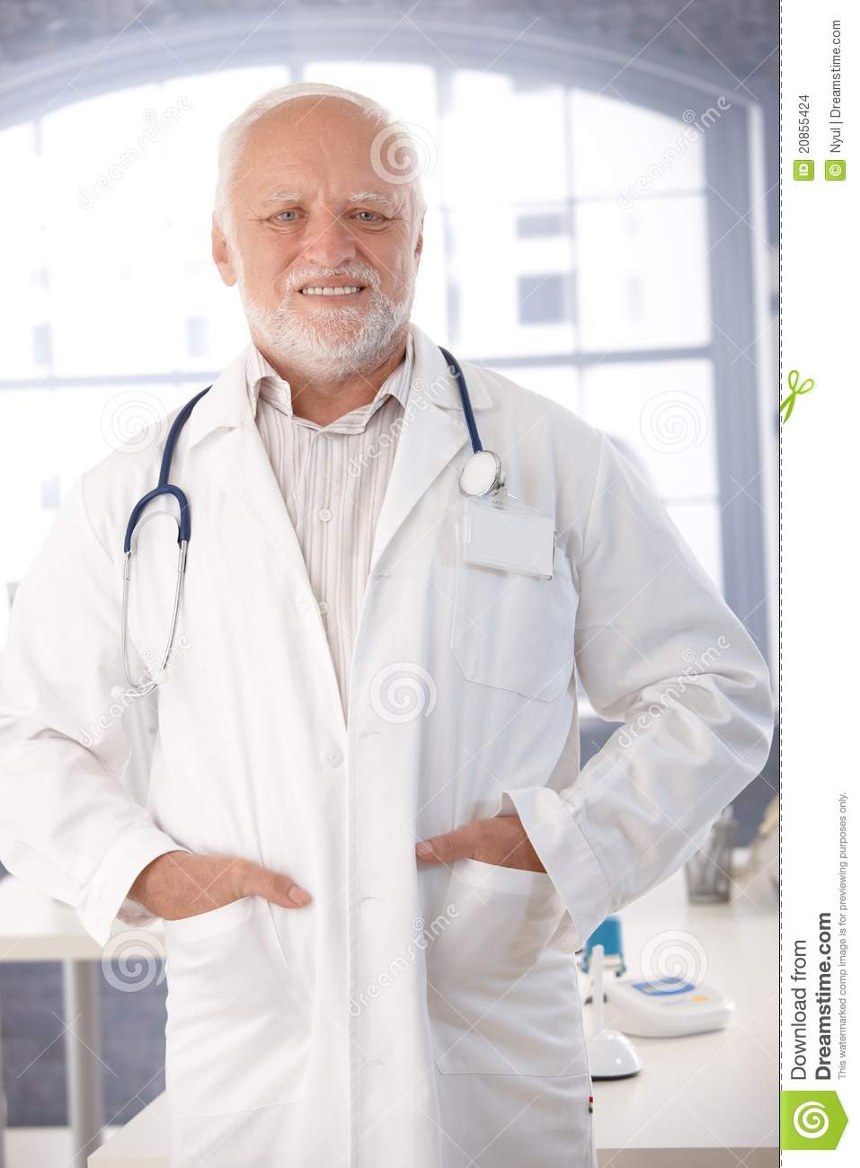 Mature Doctor Smiling In Lab Coat Stock Images