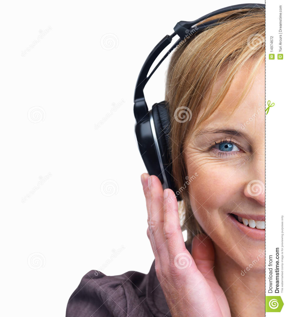 Stock Photography: Mature female listening to music on ...