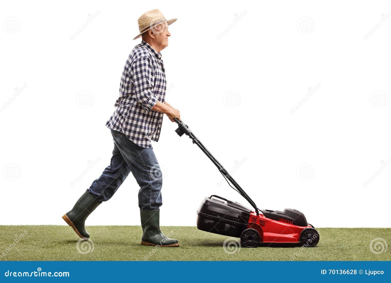 Mature gardener mowing a lawn