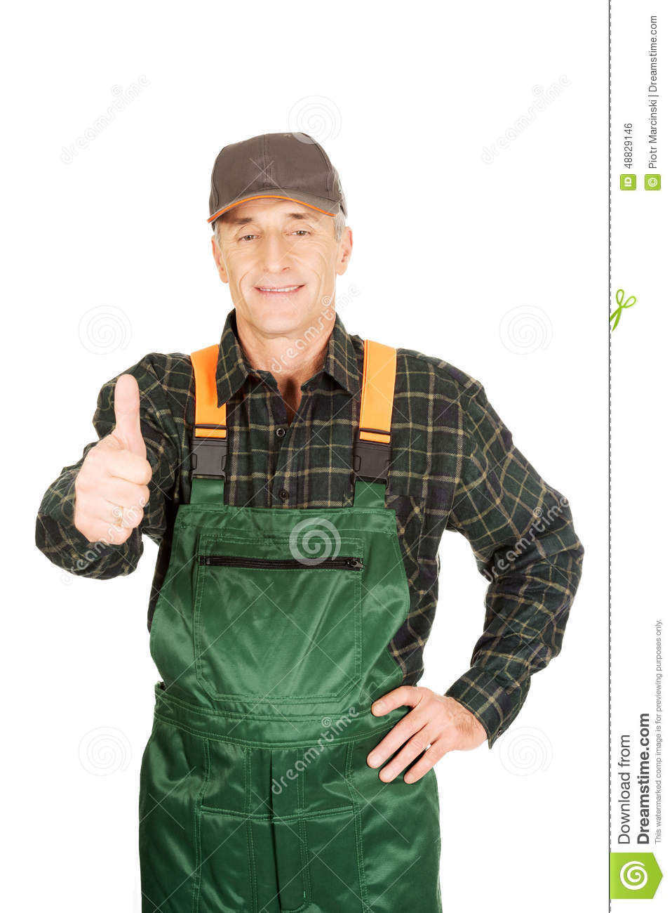 mature gardener in uniform with thumbs up stock photo - image of