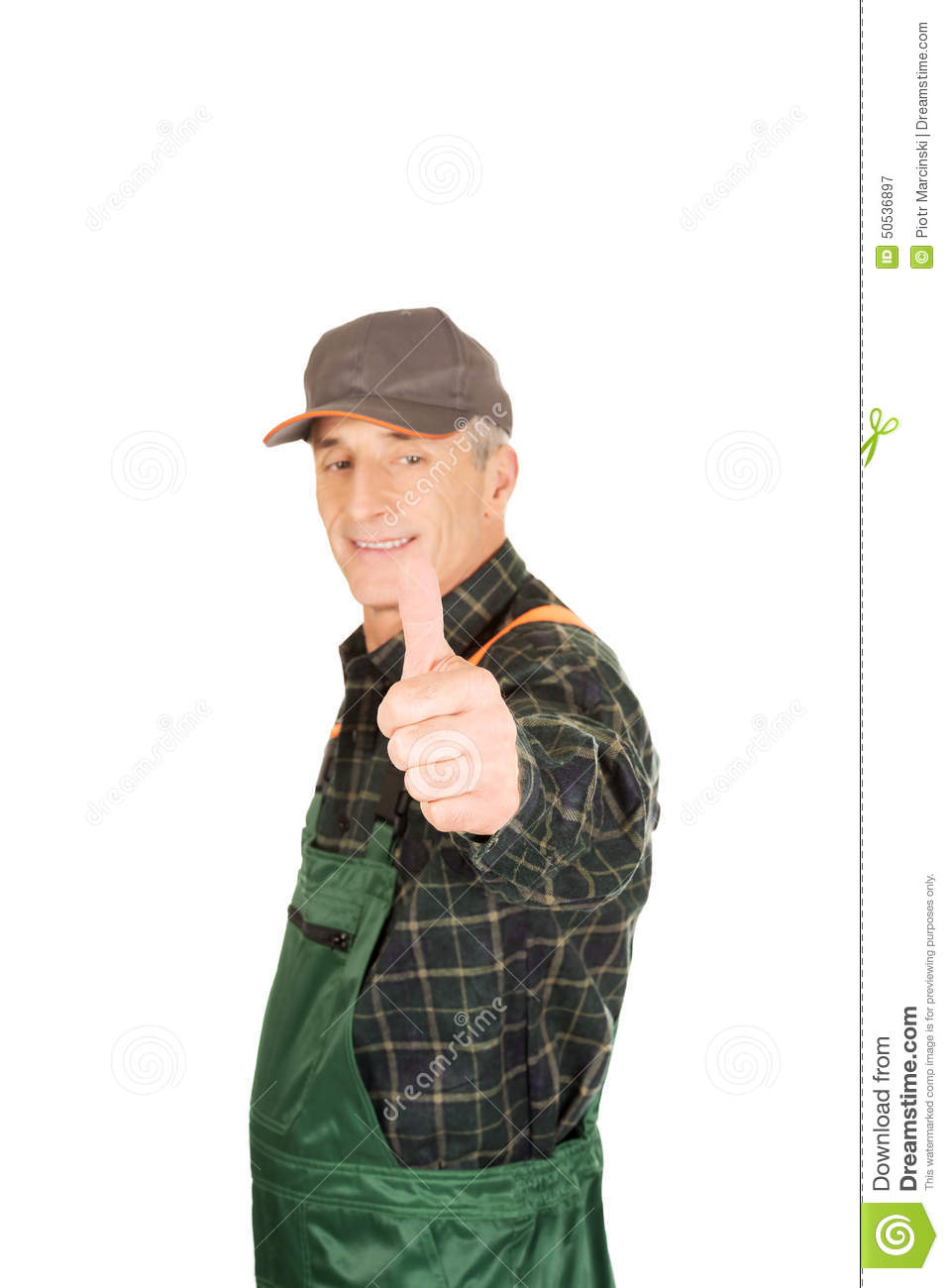 mature gardener in uniform with thumbs up stock image - image of