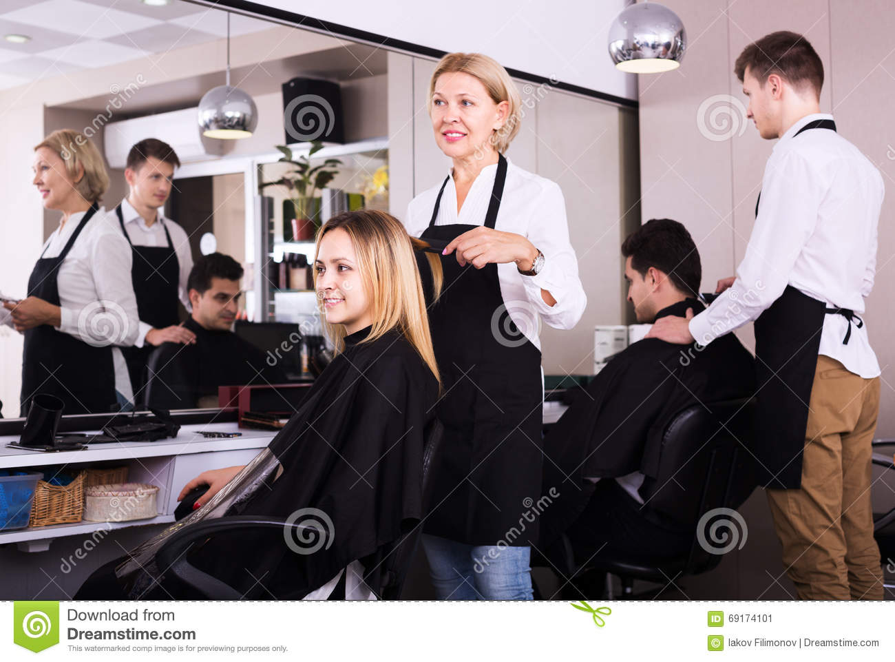 Mature hairdresser working at salon stock photo image for Salon seniors
