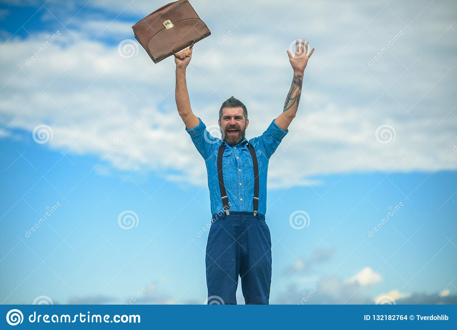 Mature hipster with beard. Brutal male. Vintage fashion bag. Going to work. Businessman. Bearded happy man with retro
