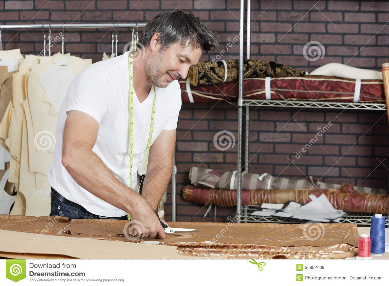 Mature Male Dressmaker Cutting Fabric In Design Studio Stock Image - Image 30852409-3849