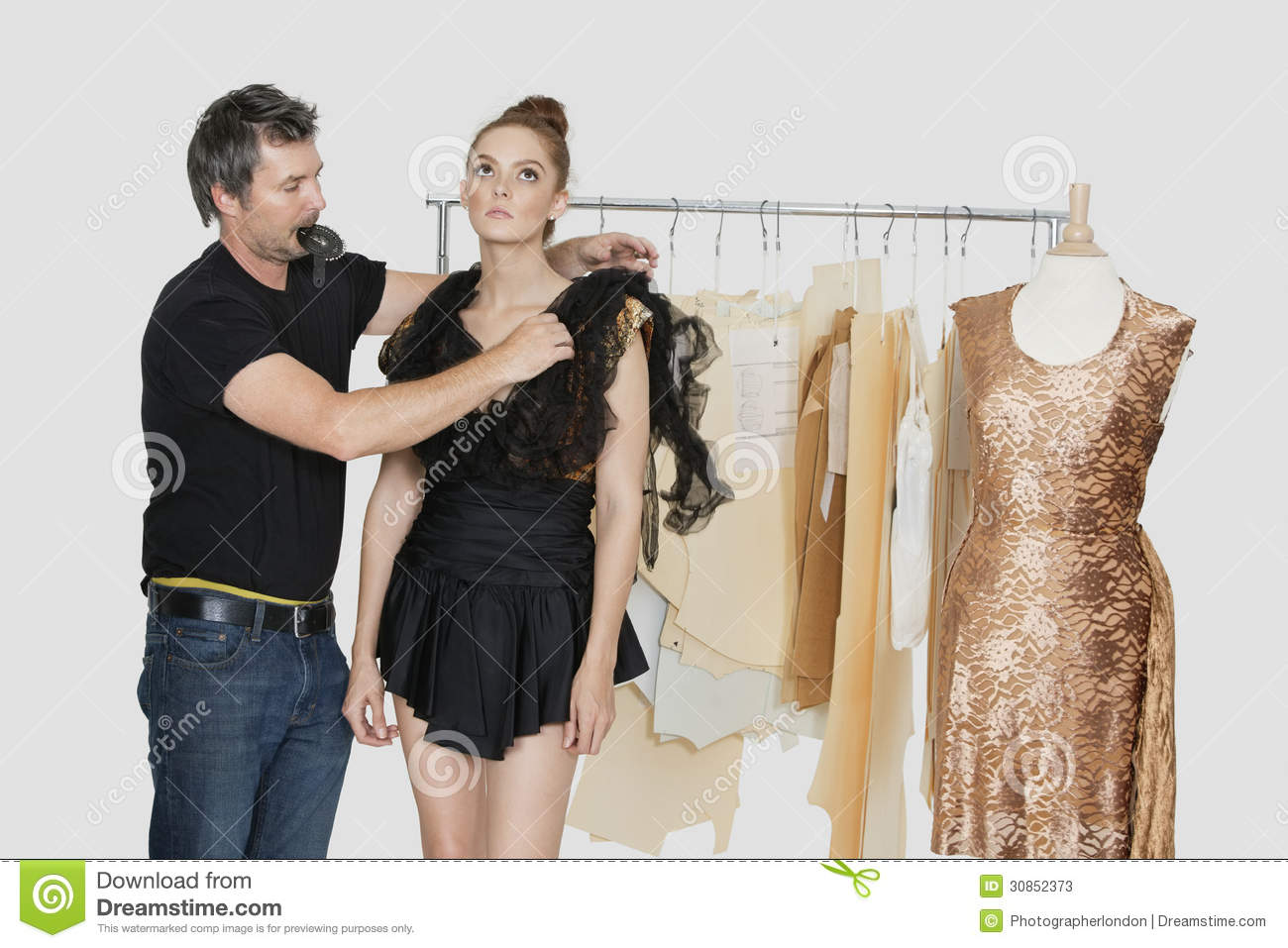 Mature Male Fashion Designer Adjusting Dress On Model In Design Studio Stock Image Image Of 2529 Paper 30852373