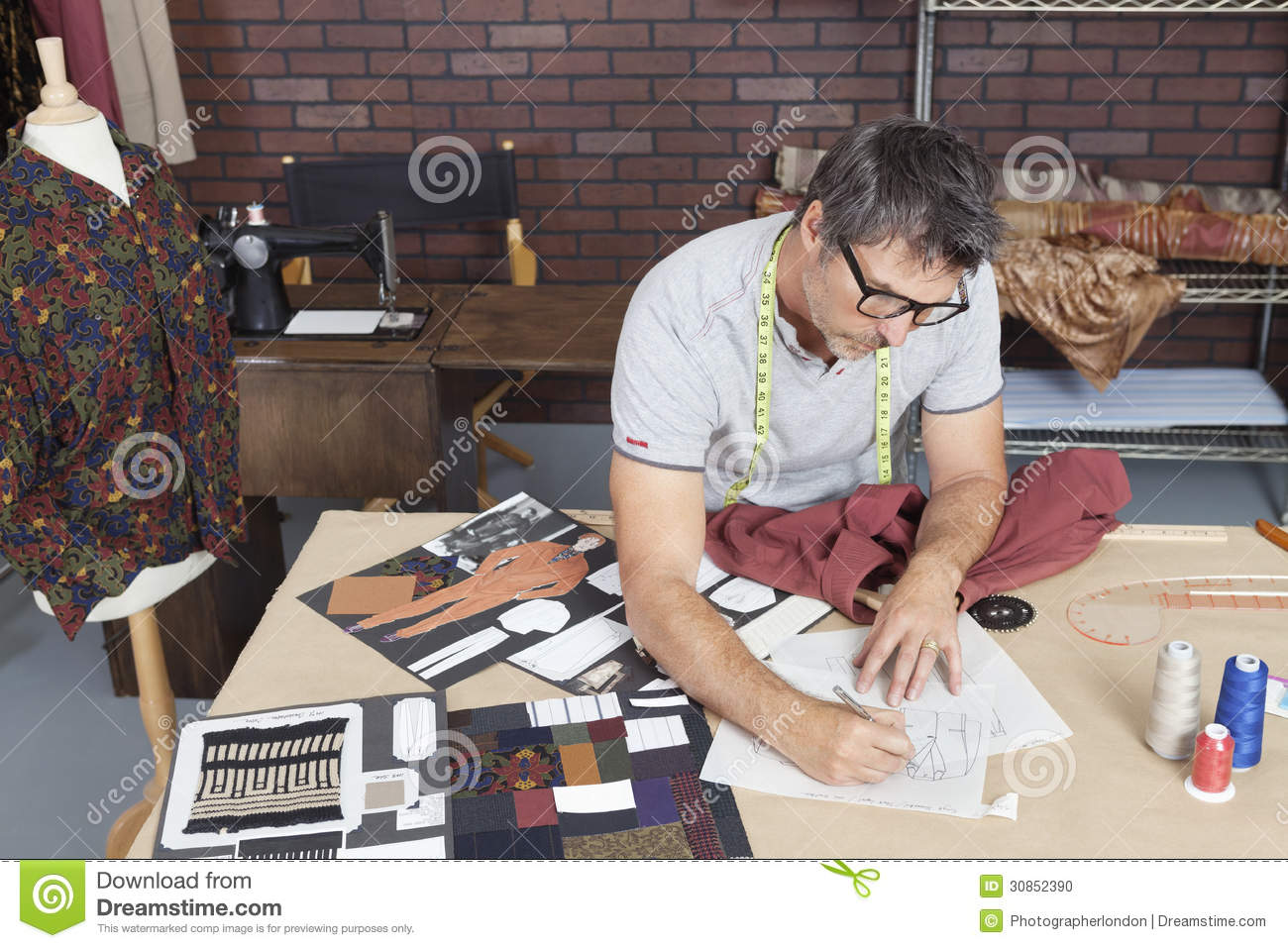 Mature male fashion designer working on sketch in design studio stock photo image of for Work from home fashion design jobs