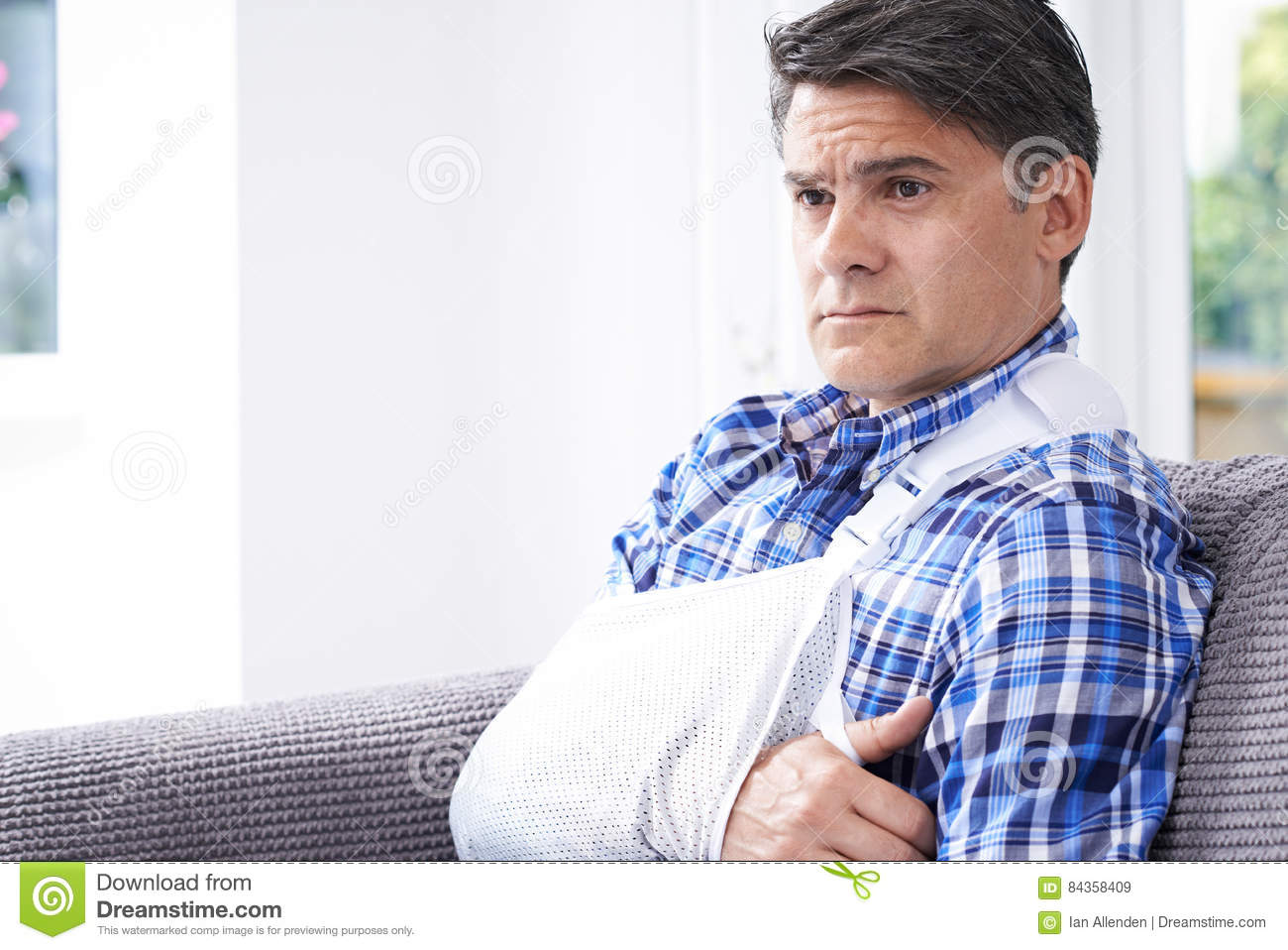Mature Man With Arm In Sling At Home