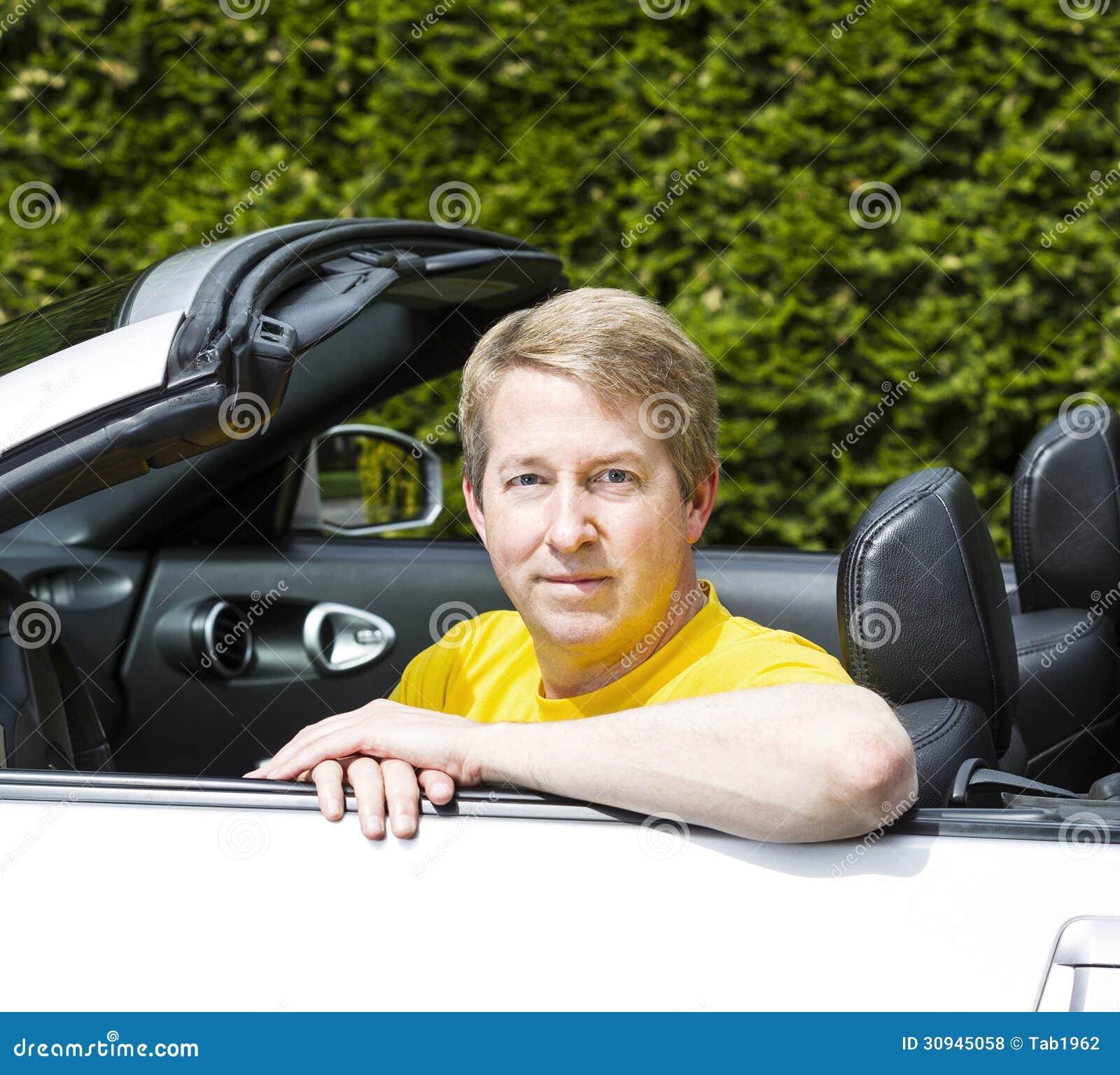 Mature Man With Arms On Top Of Convertible Car Door Stock