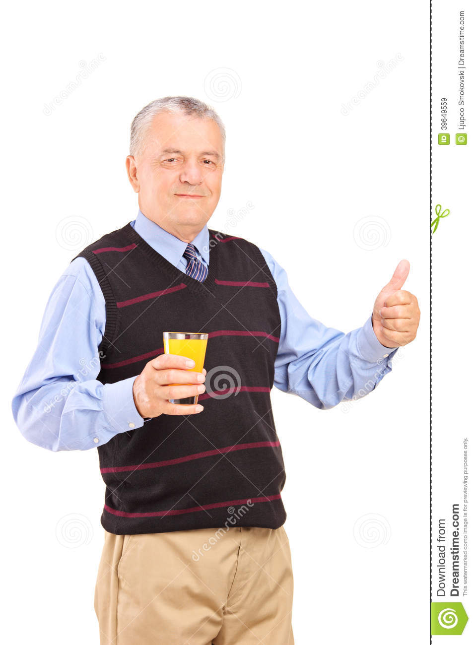 mature man holding an orange juice and giving thumb up stock image