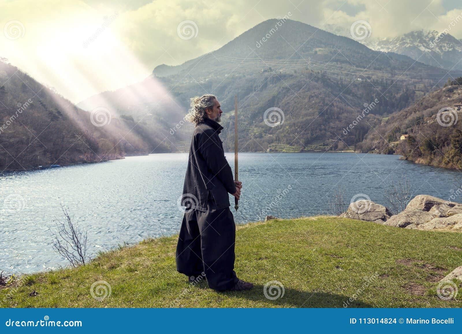 Mature man practicing Tai Chi discipline outdoors