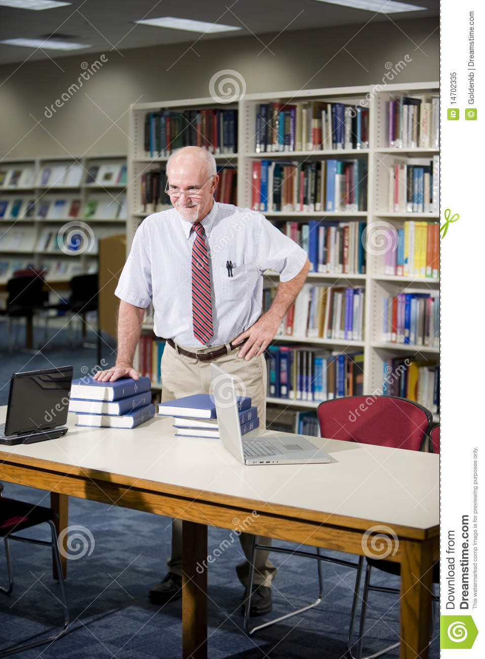 mature man researching books in library stock image image of