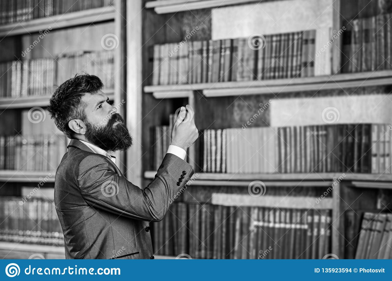 Mature Man With Serious Face Professor Stands In Big Library And Choose Book Bearded Man In Expensive Suit In His Stock Photo Image Of Boss Choice 135923594