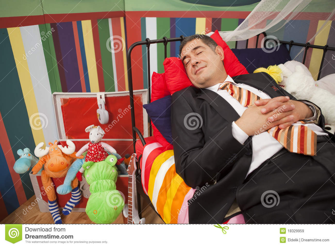 Mature man sleeping in child bed