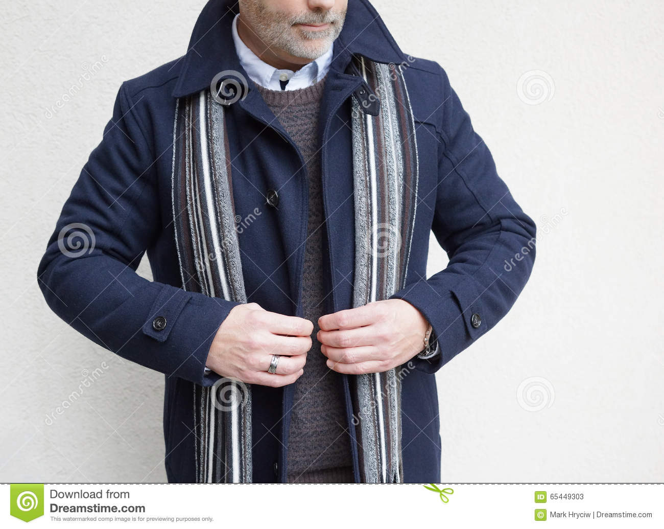 Mature Man Standing and Buttoning His Jacket