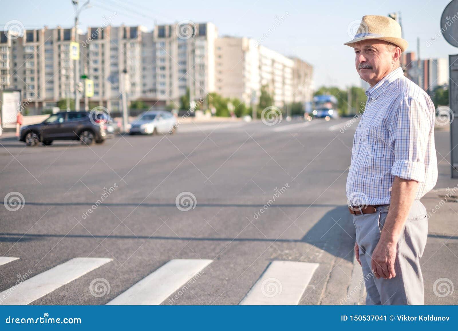Mature european man waiting to cross street