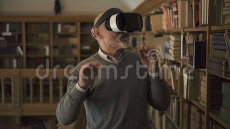 Mature man is testing virtual reality glasses standing in vintage library.