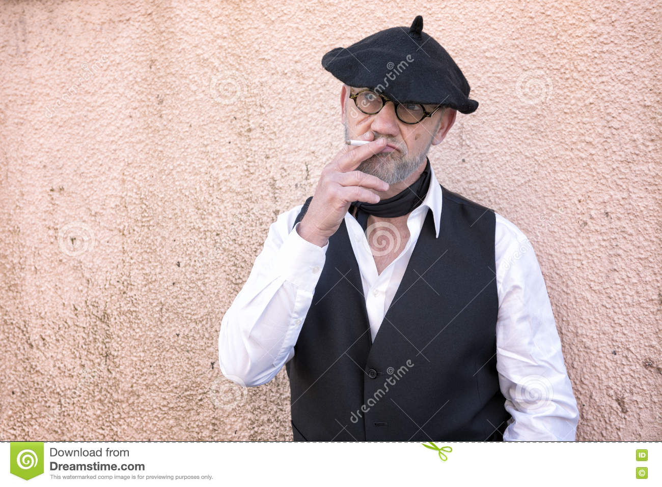 724c0c17ce36b Mature Man Wearing Traditional French Clothing Smoking A Cigarette ...