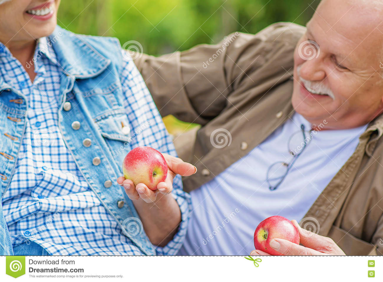 Mature man and woman caring of their health