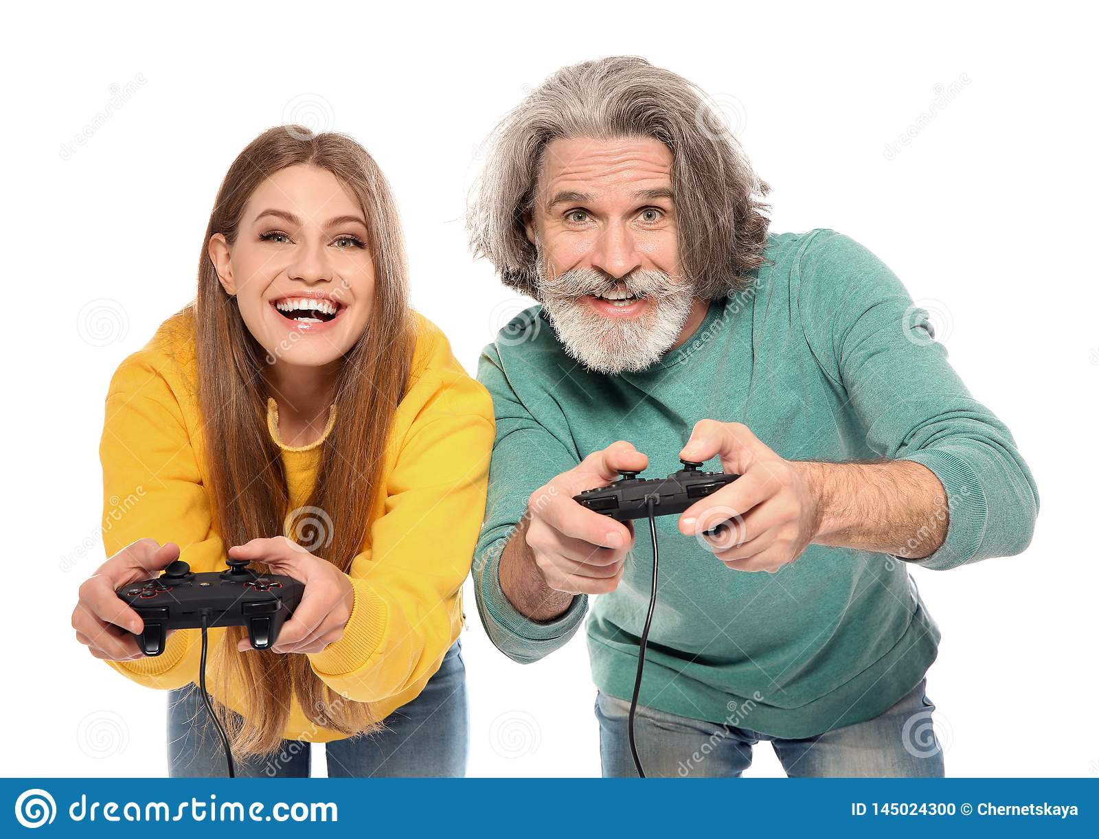 Mature man and young woman playing video games