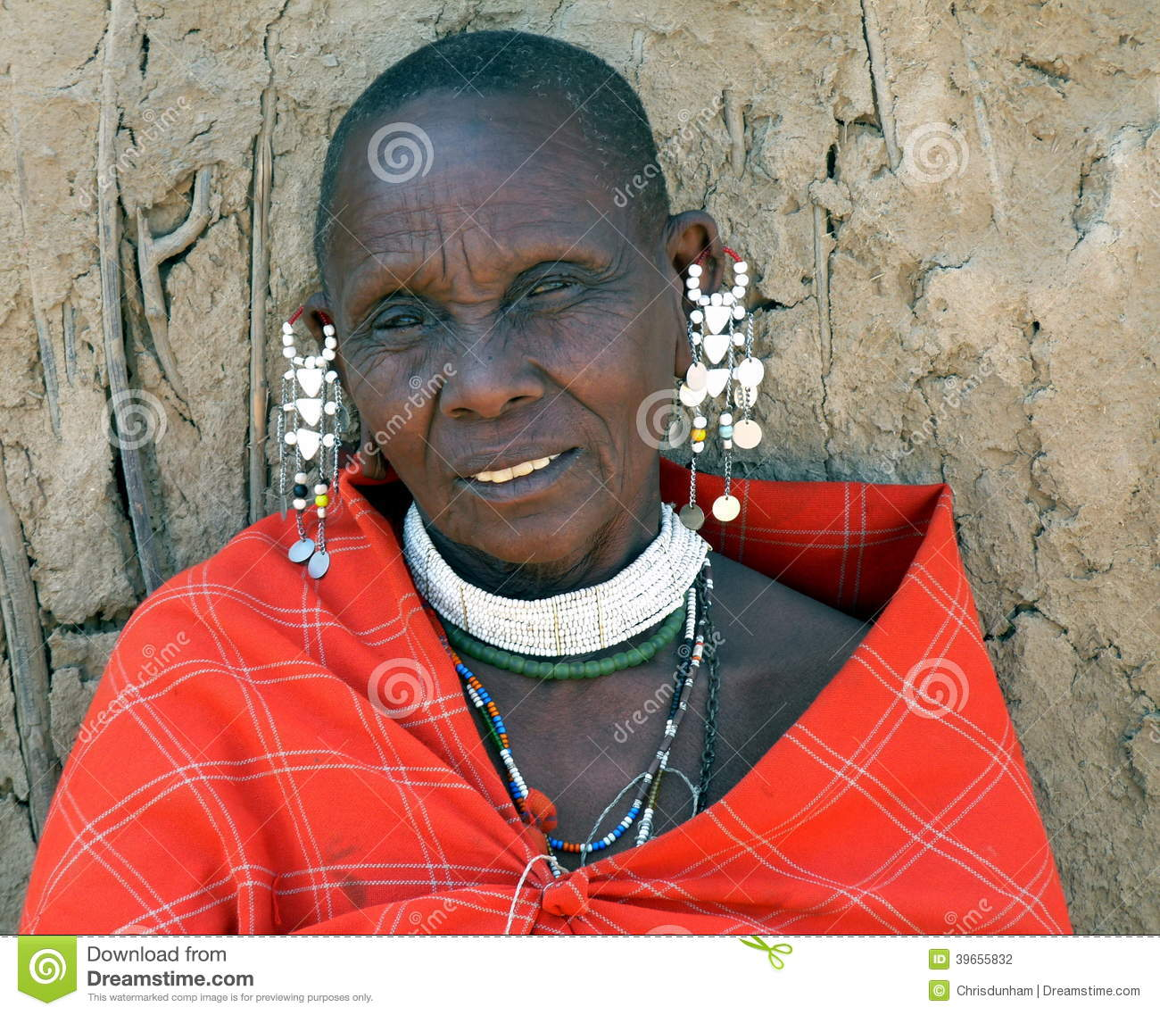 Mature Masai Woman In Traditional Dress And Jewellery