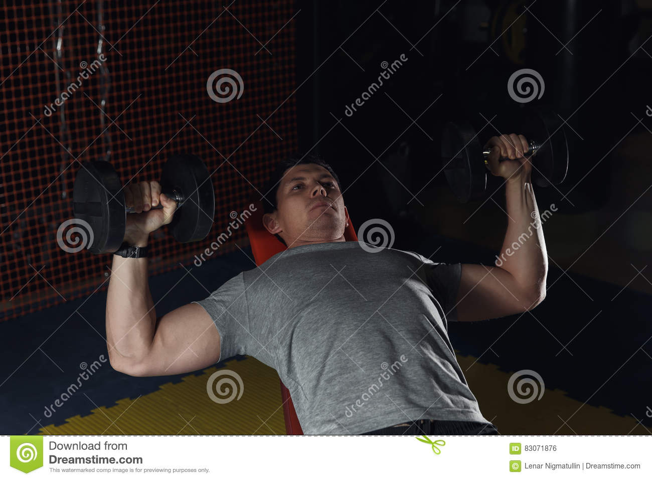Mature Men Doing Dumbbell Incline Bench Press Workout In Gym Stock