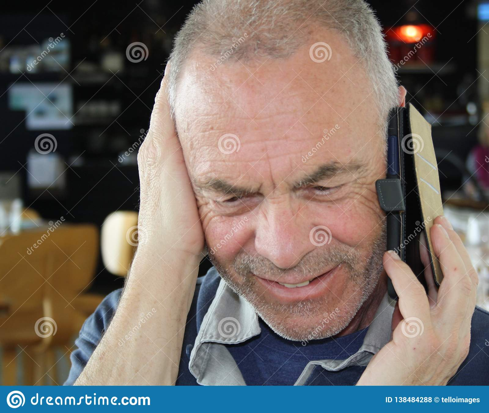 Mature older man talking on a mobile phone