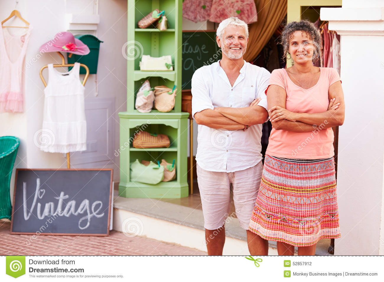 Mature Owners Of Fashion Store Standing Outside Shop�