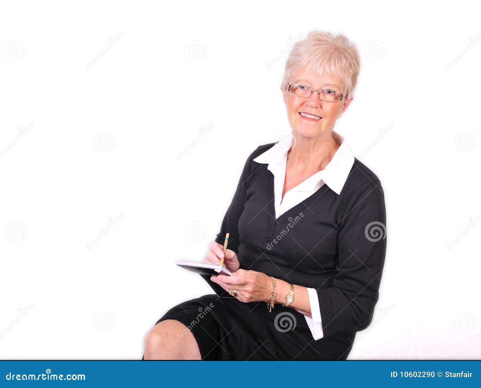 mature secretary taking notes stock photo - image of businesswoman