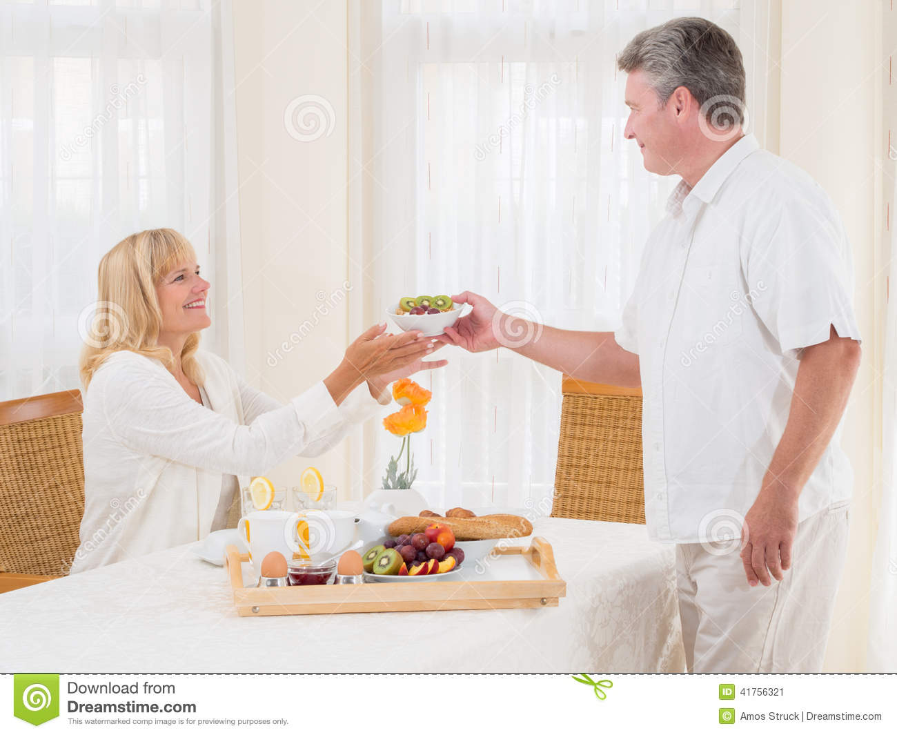Mature Senior Husband Serving His Wife Healthy Breakfast Stock Photo - Image 41756321-5517