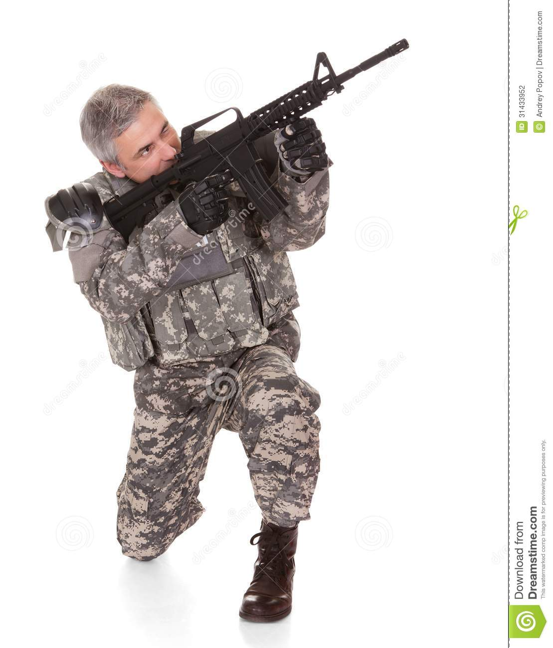 Mature Soldier Aiming With Rifle Stock Photography