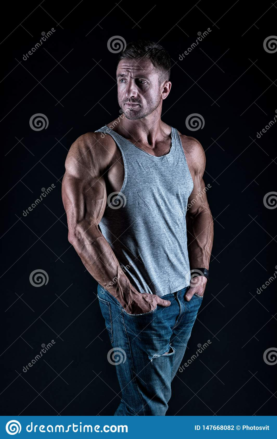 Mature sportsman. Bodybuilding concept. Strong athletic fitness man. Bodybuilding training. Strength and motivation