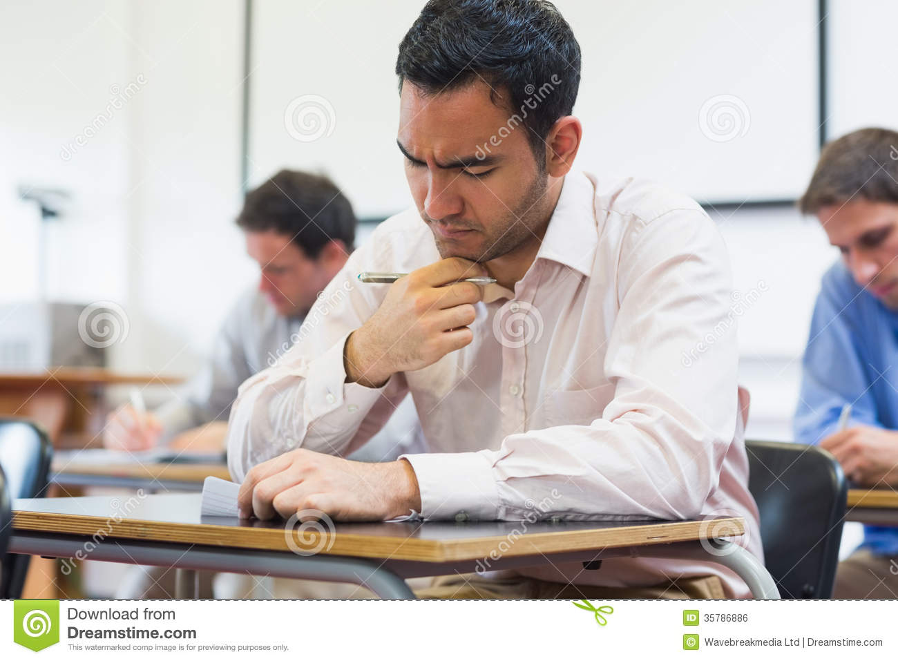 Mature Students Taking Notes In Classroom Royalty Free ...