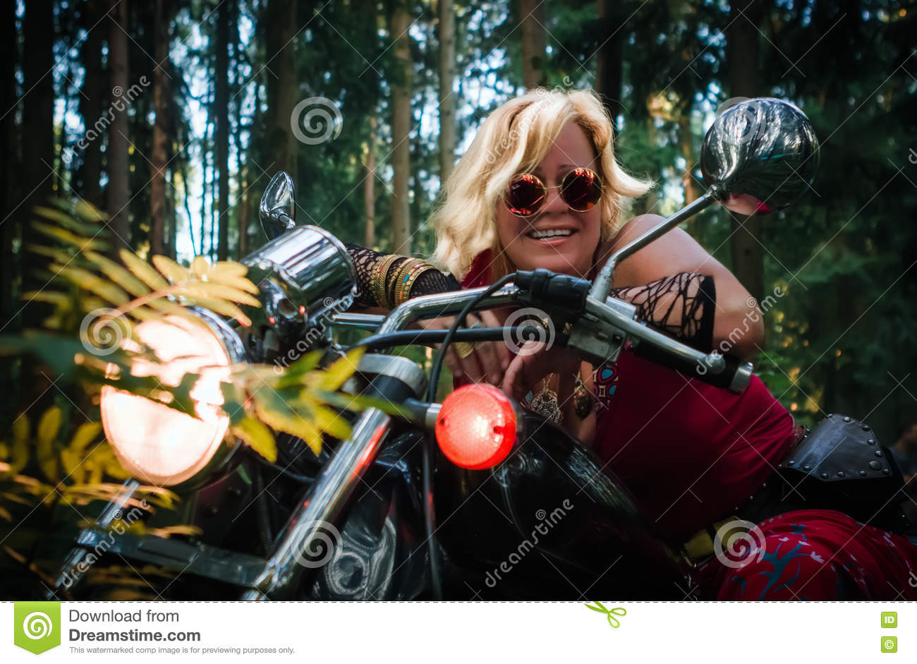 Mature woman biker on a motorcycle