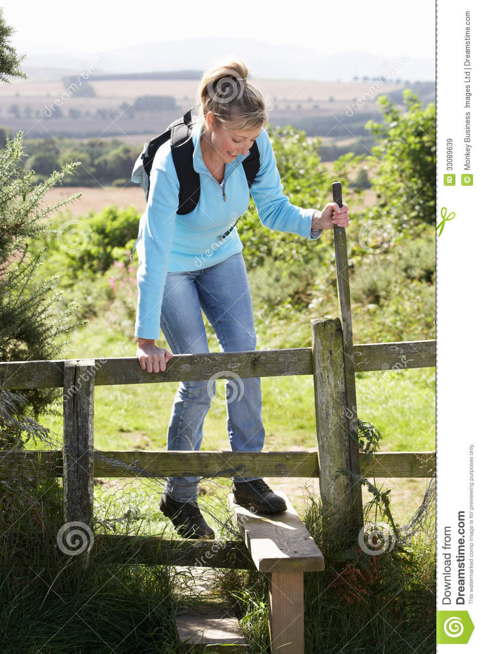 Mature Woman On Country Walk Royalty Free Stock Images