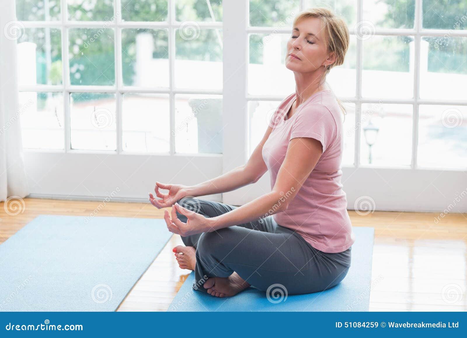 Mature Woman Doing Yoga On Fitness Mat Stock Photo Image